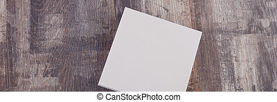 Blank paper on wood table. Office background