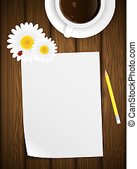 Blank paper on wooden background with flowers.