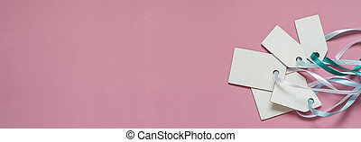 Blank paper price sale tags On pink background. Banner format