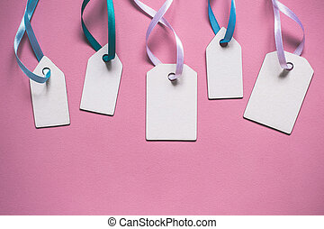 Blank paper price sale tags On pink background