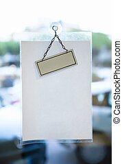 Blank paper sheet for message on glass office door