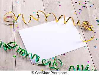 Blank paper sheet with bow on wooden background