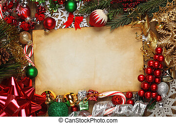 Blank paper surrounded by Christmas ornaments, decorations, and tree branches