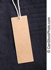 Blank paper tag on denim.