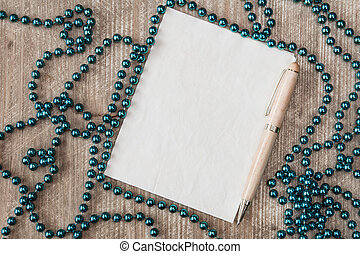 Blank paper with a pen and Christmas decorations