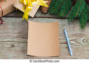 Blank paper with and Space for text. Christmas wooden background with decorations