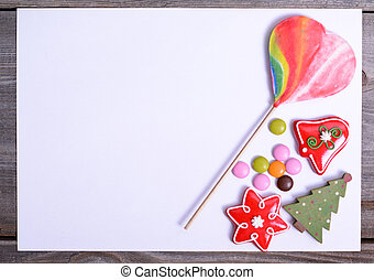 Blank paper with candy and Christmas decoration