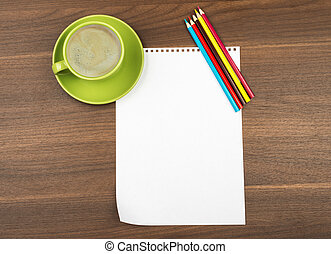 Blank paper with crayons and cup of coffee