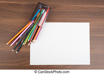 Blank paper with crayons
