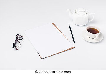 blank paper with cup of tea