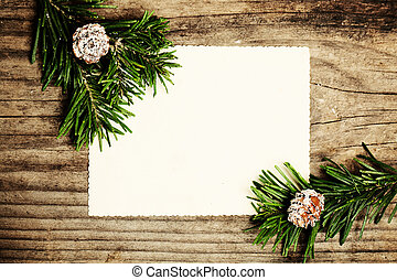 Blank Paper with Fir Branch on Wooden. Christmas Winter Background