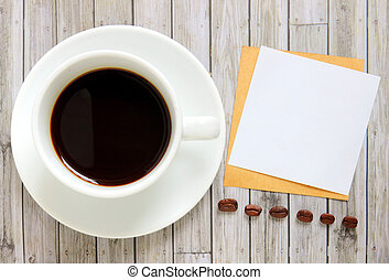 Blank paper with hot coffee cup and coffee beans