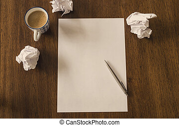 Blank paper with pen and coffee cup on wood table space for text