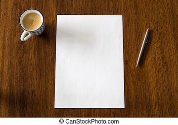 Blank paper with pen and coffee cup on wood table, space for text