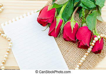 Blank paper with red roses.