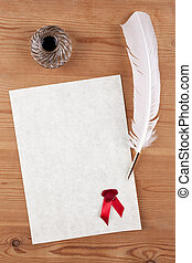 Blank parchment paper with red wax seal quill and ink well
