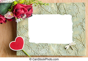 Blank photo frame and red rose.