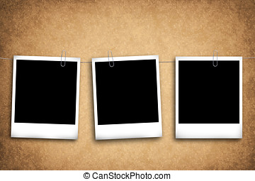 Blank photo frames on a grungy background