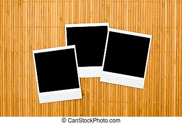 Blank photo frames on bamboo