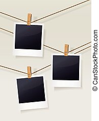 blank photo frames on clotheslines