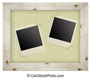 blank photo frames on cork board isolated