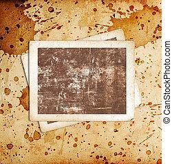 Blank photo frames on the grunge background