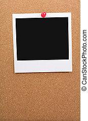 blank photo post on corkboard