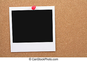 blank photo post on corkboard
