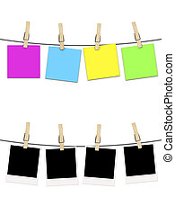 blank photographs and postcard noted  hanging on clothesline isolated over white background