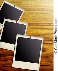 blank photos on a wood background