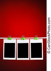 blank photos on red background - blank photos hanging on ...