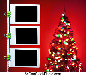 blank photos on red background with christmas tree