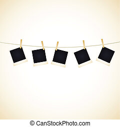 Blank Photos - Set of 5 blank photos hanging on a line. ...