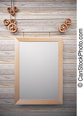 Blank picture frame in the style of steampunk hanging on wooden wall, mock up