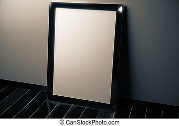 Blank picture frame on black floor in empty room, mock up