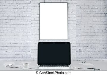 Blank picture frame on white brick wall and blank black laptop screen, mock up