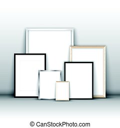 Blank picture frames against a wall - Blank picture frames...