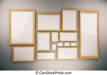 Blank picture frames composition on the wall, mock up