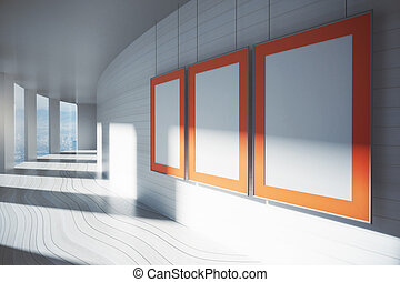 Blank picture frames in corridor - Orange picture frames in...
