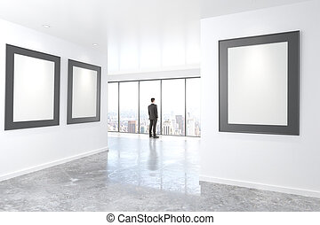 Blank picture frames on white wall in empty loft room and businessman, mock up, 3D Render
