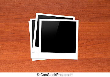 Blank Picture Frames on Wooden Table