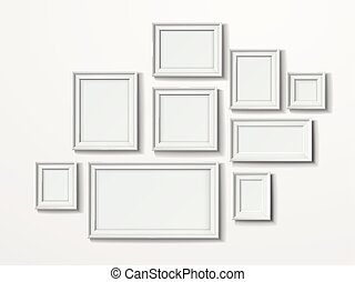 blank picture frames set isolated on white wall