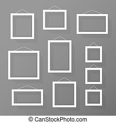 Blank picture frames set on the wall. Template for a content