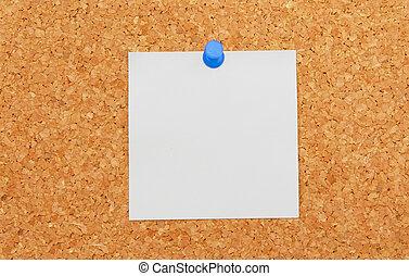 blank piece of paper on cork desk