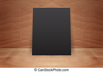Blank poster stand on a wooden background