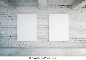 Blank posters on brick wall