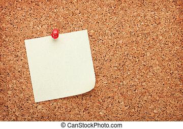 Blank postit note on cork notice board - Blank postit note...