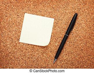 Blank postit note on cork notice board