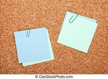 Blank postit notes on cork notice board