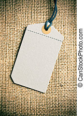 blank price tag label on burlap background